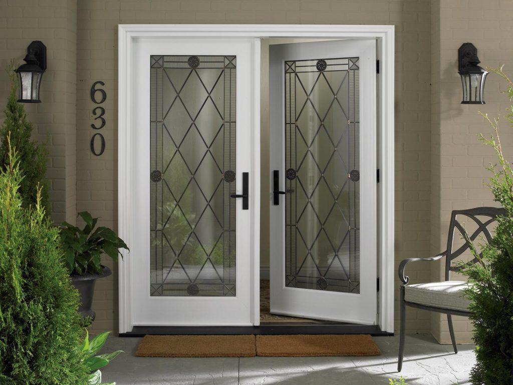 Насколько надежна и удобна стеклянная дверь в дом? фото